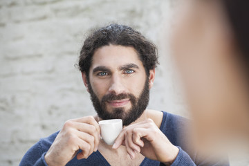 Germany, Cologne, Portrait of man with coffee cup
