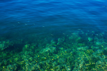 Texture of water. Transparent azure sea water of the Adriatic Sea.