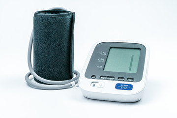 Automatic portable blood pressure machine with arm cuff isolated on white, studio shot.