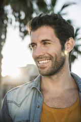 Spain, Mid adult man looking away, smiling