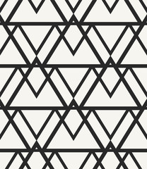 Modern stylish monochrome geometric background in trendy outlined hipster style. Repeating texture with irregular structure of triangles lined up into stylized mountain range. Vector seamless pattern.