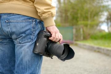 photographer holding his photo camera