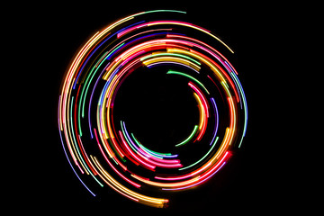 Colorful glowing neon lines circular shape.