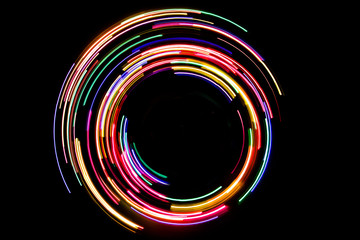 Abstract rotating neon lights texture with black empty copy space inside. Wall mural