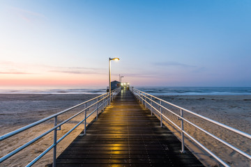 Fishing Pier in ventnor city beach in atlantic city, new jersey at sunrise Wall mural