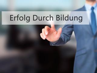 Erfolg Durch Bildung (Success Through Training in German) - Businessman hand pressing button on touch screen interface.