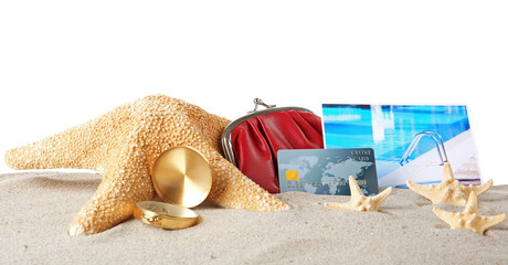 Sand with credit card, starfish and wallet on white background