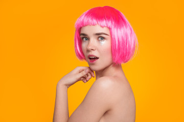 Lovely girl in pink wig posing