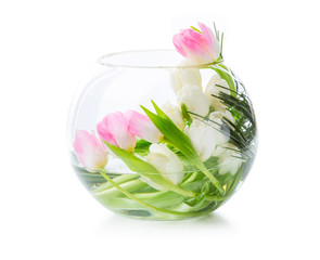 Pink and white tulips in glass vase