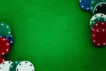 Green felt and playing chips abstract background.
