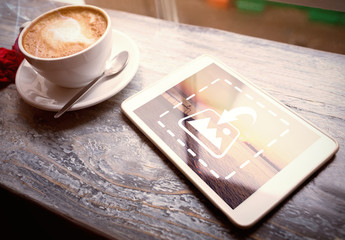 Tablet on Table with Coffee Mug Mockup 1