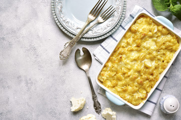 Mac and cheese with cauliflower in a baking dish .Top view with copy space.