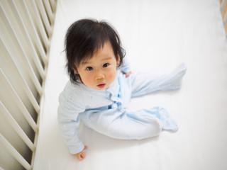 baby girl in cot