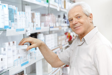 Senior male customer choosing products at the store