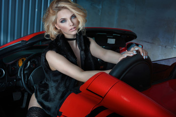 Sexy blonde girl in sports car.