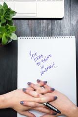 Female cracking fingers while writing