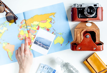 tourist lifestyle with camera and map white table background top view