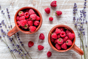 raspberry composition with dry lavender rustic background top view