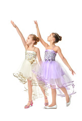 Cute little dancers on white background