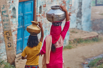 Vrindavan, 22 October 2016: Two women carrying jars on their head, in Vrindavan, UP