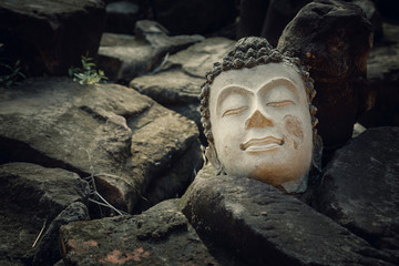 Ruins of Image Buddha Head at Phutthaisawan Temple in Ayutthaya Historical Park, UNESCO World Heritage Site in Thailand