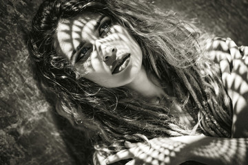 young beautiful woman with shadows on face