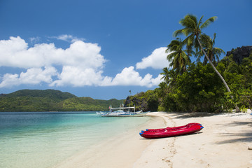 Beautiful beach with kayaks and boat in Palawan, Philippines