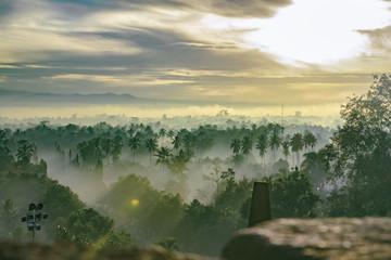 Sunrise over the ancient temple complex of Borobudur on the island of Java (Indonesia)