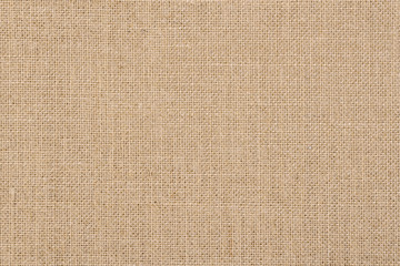 A background of a scratchy burlack material in an even light brown color.