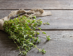 Thyme bunch on old wooden table