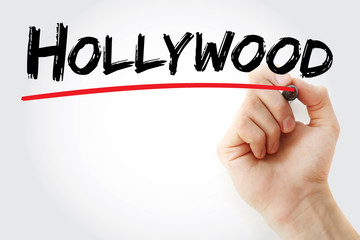Hand writing Hollywood with marker, concept background