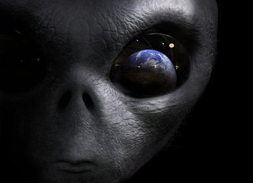 alien looking at the earth