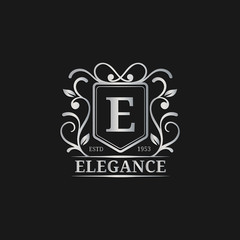 Vector monogram logo template. Luxury letter design. Graceful vintage character illustration. Used for hotel etc.