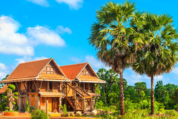Thai country house and blue sky.