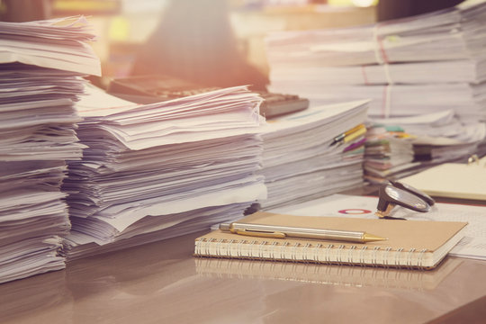 Business Concept, Pile of unfinished documents on office desk, Stack of business paper, Vintage Effect