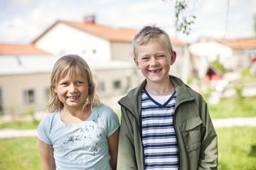 Portrait of happy elementary students schoolyard
