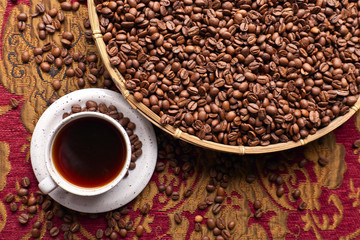 Cup of black coffee and  beans
