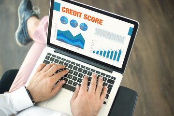 Business Charts and Graphs on screen with CREDIT SCORE title