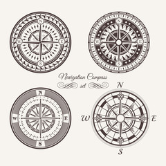 Isolated vintage or old marine compass rose icons. Sea or ocean navigation. Retro cartography icon or traveler compass sign, wind rose icon set.