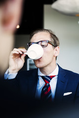 Businessman having coffee at cafe