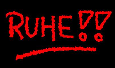 Ruhe-Symbol mit roter Schrift auf schwarzer Tafel