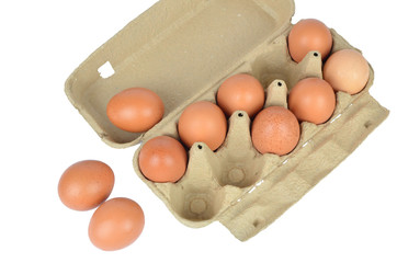 Open cardboard box with chicken eggs on white background