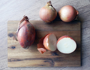 detail photography of vintage kitchen still life with onions on wooden table