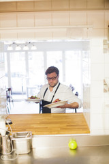 Chef holding dishes at commercial kitchen