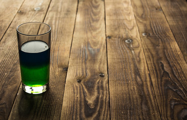 two layers green and blue alcohol coctail