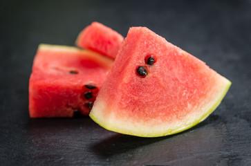 Some Sliced Watermelon on a dark slate slab