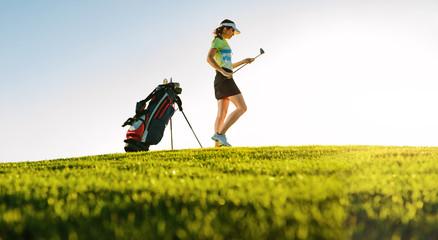 Professional female golfer on golf course