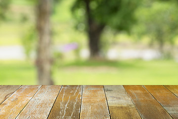 Empty top wooden table and sunny abstract blurred background