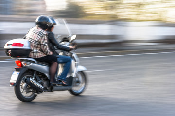 Couple on a Scooter (Motion Pan)