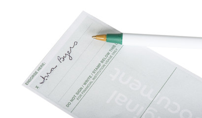 Endorsed personal check with a fake signature and pen isolated on white